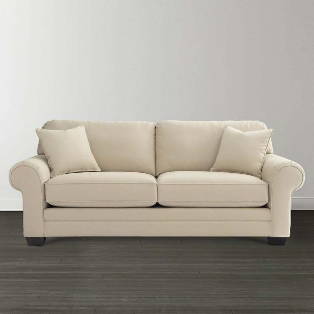 Small elegant custom sectional sofa idea with white fabric covering comfortable sectional love seat and gray grain wood textured laminated flooring also soft gray living room wall paint