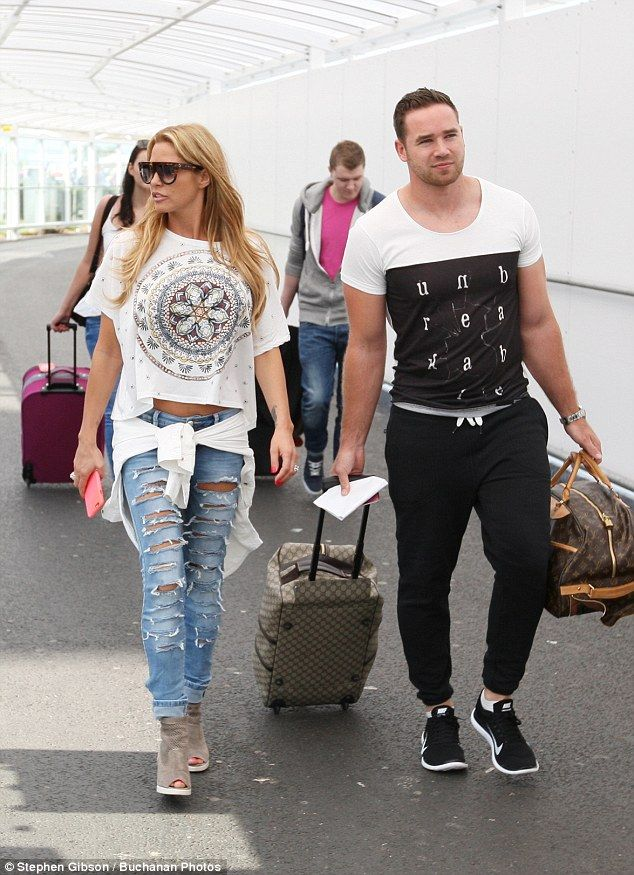 Jet-setters: Katie Price and her husband Kieran Hayler arrived at Glasgow airport on Sunday morning following a fun-filled Scottish minibreak