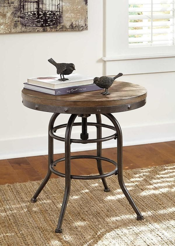 "We took a turn-of-the-century drafting seat and re-purposed it as a well-rounded end table. Vennilux's dark metal frame has a butcher-block styled contrasting top accented with ""riveted"" trim. Contrary to appearance, the top remains stationary."