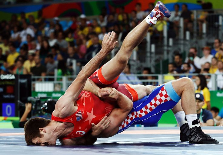 #olympics #olympiad #olympians  Andy Bisek of the United States, in red, grappling with Bozo Starcevic of Croatia in the Greco-Roman wrestling quarterfinals. Bisek lost, 3-0.