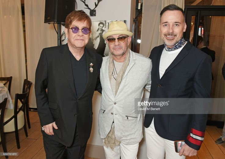 Sir Elton John, Bernie Taupin and David Furnish attend a lunch celebrating the World Premiere of 'The Cut', Sir Elton John and Bernie Taupin's classics 'Rocket Man', 'Tiny Dancer' and 'Bennie And The Jets' reimagined in video, supported by YouTube at The Cannes Film Festival at the Hotel Barriere Le Majestic on May 22, 2017 in Cannes, France.