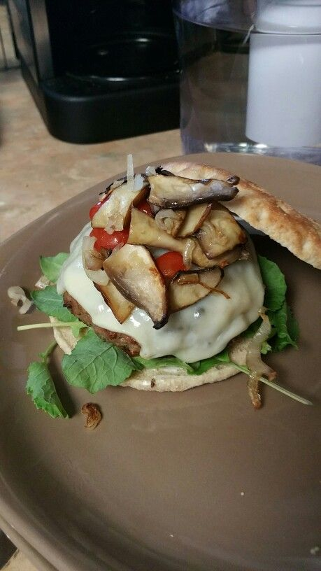 Turkey burger with swiss cheese and sautéed mushrooms, peppers and onions  Mix GROUND TURKEY, PUREE (SHALLOTS, GARLIC, SALT, PEPPER, CHILI POWDER), BREAD CRUMBS  Form patties, put in the fridge for 30 minutes  Fry OR Grill  Serve with BUN, SPINACH, MUSHROOMS, SWISS, HOT PEPPERS