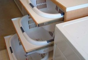 Contemporary Laundry Room with limestone tile floors, DIY Laundry Basket Dresser, Pull out laundry baskets