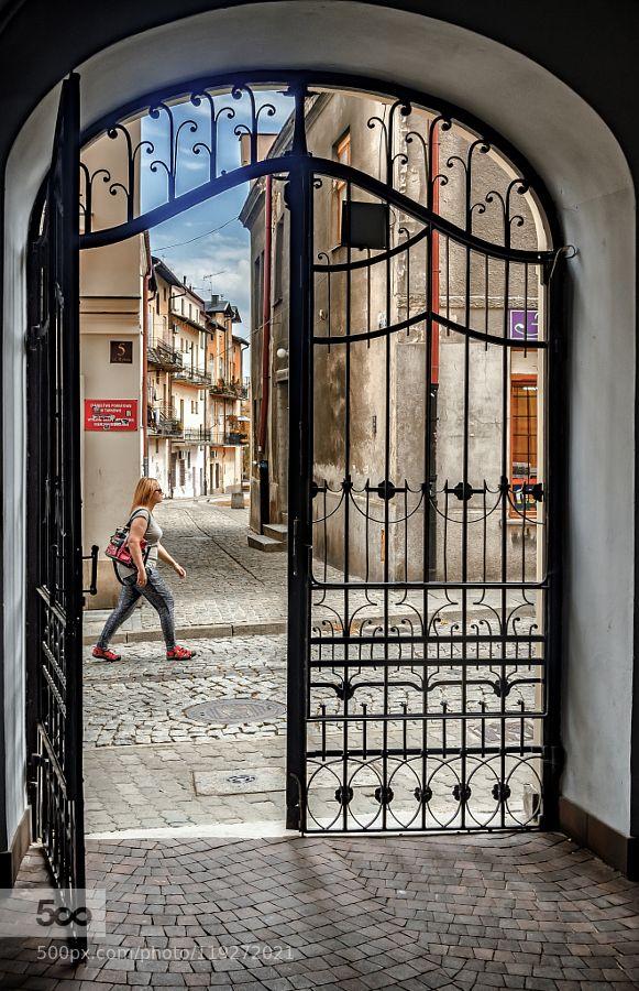 gate - Pinned by Mak Khalaf old town - Tarnow - Poland City and Architecture PolandTarnowarchitecturebluebuildingcitycloudsgatelightoldskystreetsummertravelurban by mlatocha
