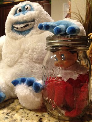 """Lookie what he can do!""~ I'm not into this elf on the shelf thing, but I think this elf in a jar is funny! Mostly because of the Abominable Snow Monster is holding the elf prisoner!"