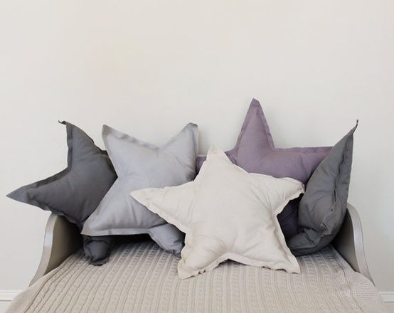 Star-shaped pillows for a child's room, especially for a outer space themed nursery