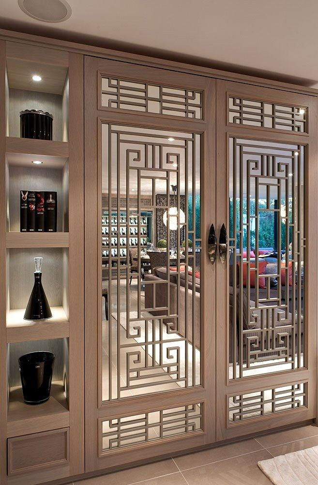 Built in cabinetry with stunning fretwork, mirroring and lacquer © Hill House Interiors