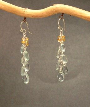 Faceted orange sapphire and aquamarine earrings Princess 99 by CalicoJunoJewelry on Etsy https://www.etsy.com/listing/114542472/faceted-orange-sapphire-and-aquamarine