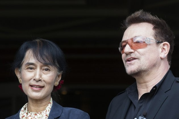 Irish singer and activist Bono and Myanmar's opposition leader Aung San Suu Kyi, left, pose for the media after attending a conference of the Oslo Forum at the Losby Gods resort,