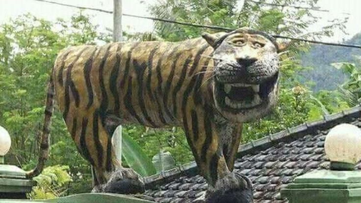 Indonesian military has removed a statue of a grinning, cartoon-like tiger from outside an army base after it sparked a flood of online mockery