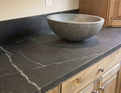 Love soapstone counters, plus they give a little nod to all that time I spent in Chem lab!