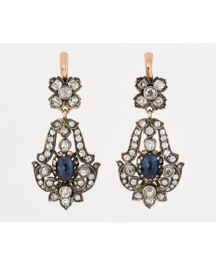 A PAIR OF ANTIQUE RUSSIAN DIAMOND AND SAPPHIRE DROP EARRINGS, MARKED AT, BEFORE 1926. Of floral design, the section at the ear post in the form of a four-petaled flower, the bottom section with a sapphire cabochon surrounded by foliate scrollwork set with diamonds.