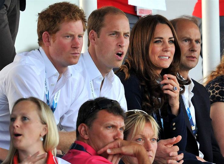 Prince Harry, Prince William and Duchess Kate react as they watch the women's field hockey match between Wales and Scotland at the Glasgow National Hockey Centre during the 2014 Commonwealth Games in Glasgow, Scotland on Monday.