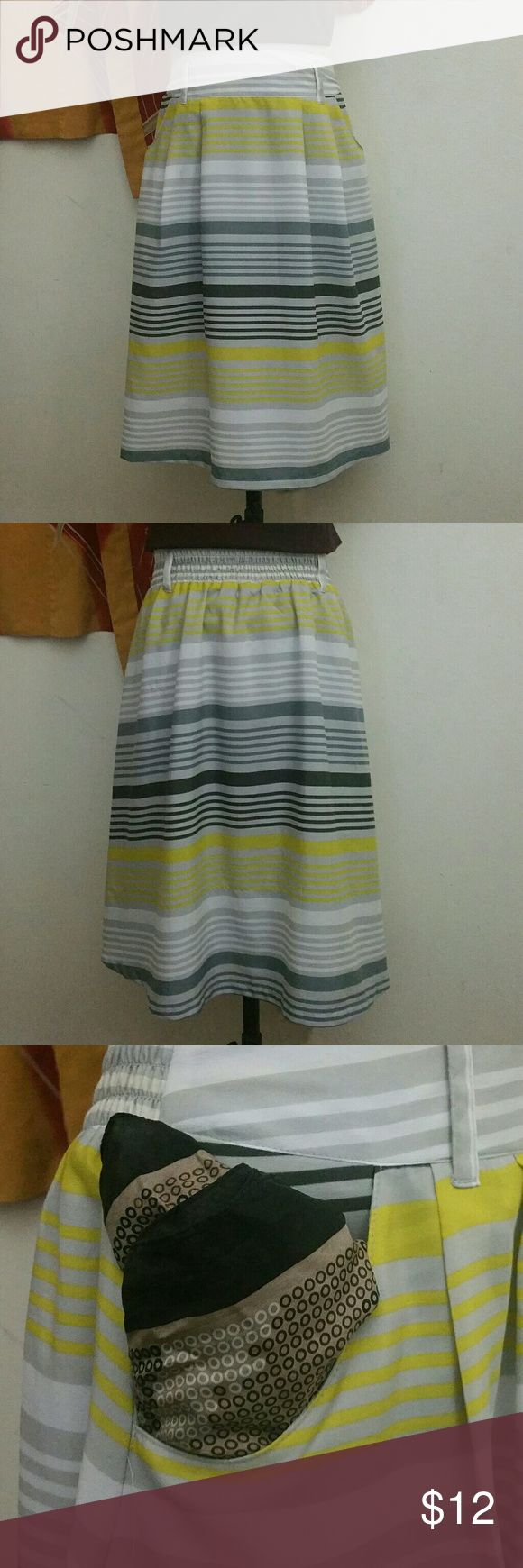 Old Navy Stripe Skirt Old Navy stripe skirt size medium. It is Grey, Yellow, Black, White. It's elastic waistband, 2 pockets, and belt loops. This is in excellent condition. The blouse is also available on my page Old Navy Skirts A-Line or Full