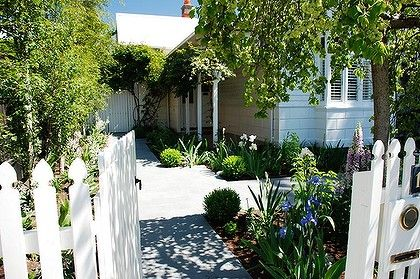White wooden picket fences and gates ensure a friendly welcome to your property