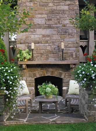 Outdoor Living - love the stone fireplace