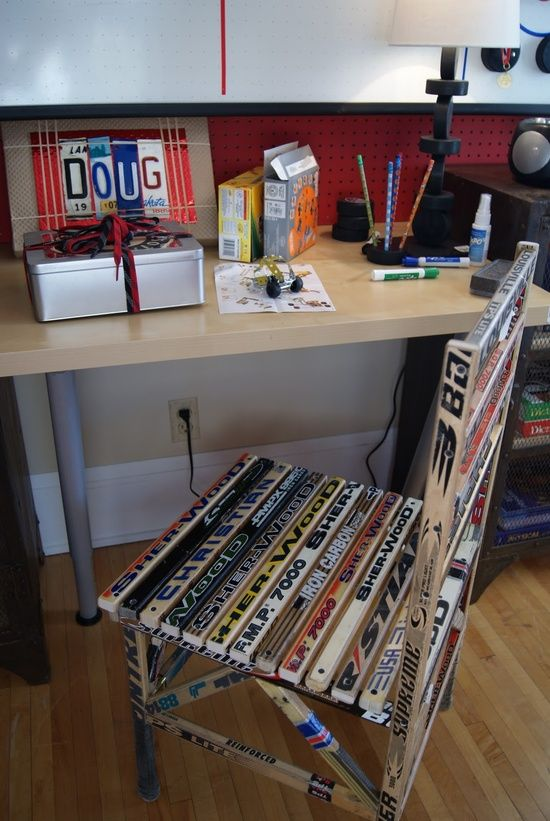 I have seen hockey stick chair before. This actually looks pretty nice in this room.   Previous pinner:  hockey sticks turned into a chair, packages decorated w/shoelaces, license plate letters,