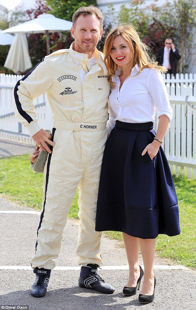 Stylish supporter: Geri Halliwell put on an effortlessly chic display in an unbuttoned white shirt and a navy midi skirt as she supported her new husband Christian Horner at The Goodwood Revival Festival on Friday