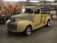 Owner: John Thompson      This 1946 Chevy short bed from Pittsburg, Kansas, may look stock, however, it's anything but! It is a blend of the character of the pre-war vehicles mixed with today's technology. When I bought the truck it was almost all ...