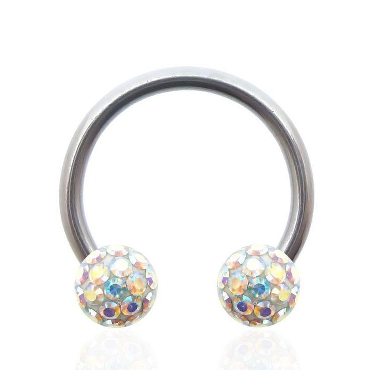 Piercing intime fer à cheval en acier chirurgical et boule en cristal de Swarovski. C-bo.fr, spécialiste bijoux piercing de qualité.