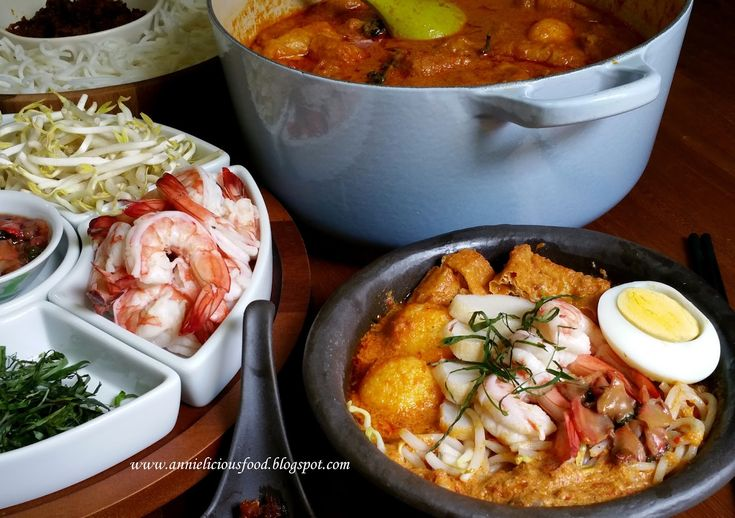 Seafood-rich and creamy coconut milk curry-like gravy with a lingering spice kick, enjoy together with noodles and the rest of the fresh ing...