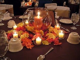 Use daisies or flower petals around the bowl instead of leaves, but I like the candle in the center :)
