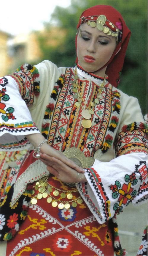 A Bulgarian girl in a Pirin region costume.