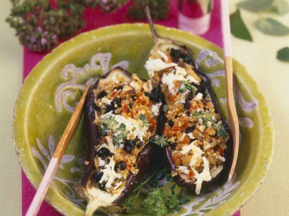 Auberginen mit Quinoa-Füllung ist ein Rezept mit frischen Zutaten aus der Kategorie Fruchtgemüse. Probieren Sie dieses und weitere Rezepte von EAT SMARTER!