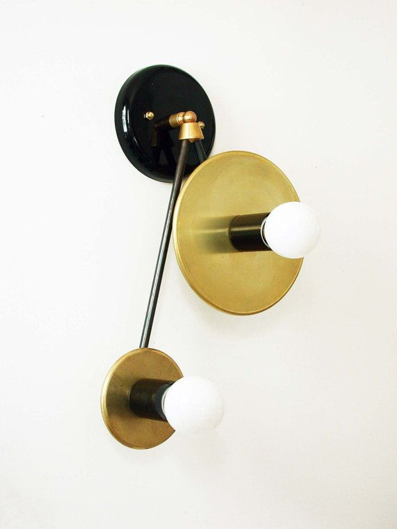 This Mid Century double brass wall sconce is a unique design piece handmade and handcrafted in our studio with sustainable materials. An elegant