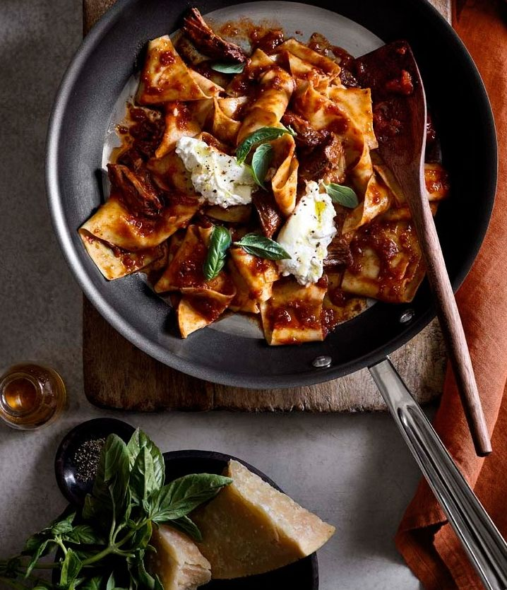 Pappardelle with Pork Ragù and Burrata | In this recipe, a sauce made from slow-cooked pork is topped with burrata, a ball of fresh mozzarella with a creamy center, for an especially impressive pasta dinner.