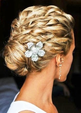 Bride's multi braid chignon bun bridal hair ideas Toni Kami Wedding Hairstyles ♥ ❶ with Swarovski flower pin