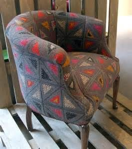 Wool Folklore fabric by Kit Kemp for Christopher Farr Cloth on a chair ...