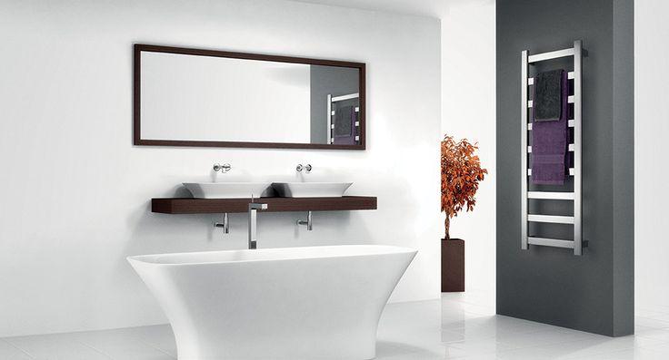 An On Trend bathroom featuring the Avenir Hybrid heated towel rail. We love it!