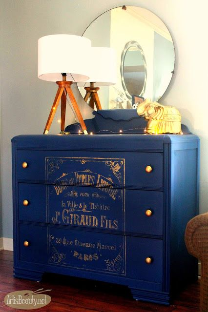 Vintage thrifted dresser painted a glossy deep cobalt blue decorated with bohemian accents