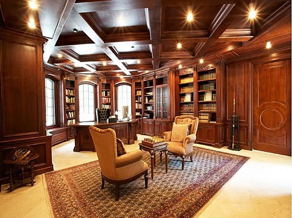 Dark wood paneling pairs well with dusty books and red wine. #libraries  #office