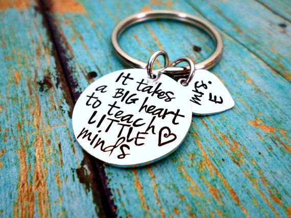 "A beautiful 1 inch circle is stamped with 'It Takes A Big Heart To Teach Little Minds"". The listing also includes an adorable heart charm that you can customize - Leave Name in NOTES box at checkout.      Several ways to CUSTOMIZE your keychain: (click on links and add to cart)    Add an initial charm- https://www.etsy.com/listing/180681081  Add a birthstone- https://www.etsy.com/listing/173830712    Other Charm Options:  Family Member Charms---> https://www.etsy.com/listing/181495868   Animal C"