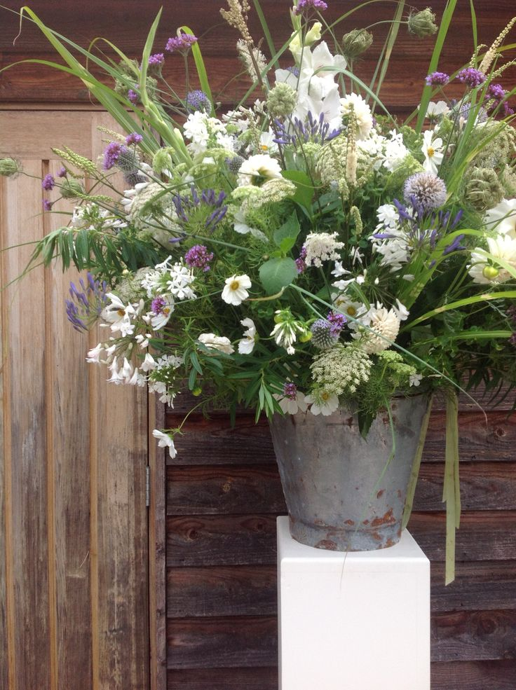 Vintage Bucket of Agapanthus, phlox, equinox, verbena ready for church