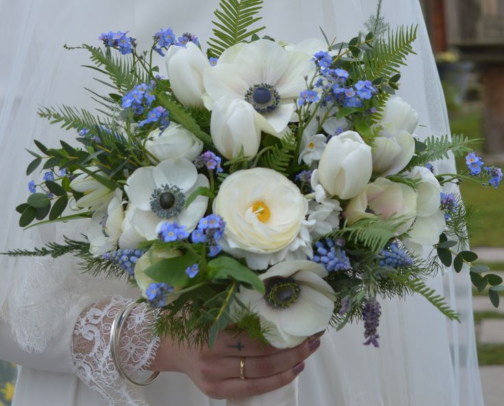Spring flower bridal bouquet using British tulips, anemones, blue muscari, forget-me-nots, white ranunculus. The addition of ferns and soft foliage creates a soft vintage look.