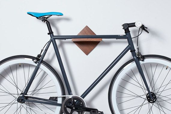 Check out our new bike rack https://www.etsy.com/listing/474433307/wall-mount-bike-rack-solid-wood-timber?ref=shop_home_active_1 --- now 20% OFF international orders (non-USA) - Coupon Code INTL20 --- VISIT OUR BRAND PAGE AT lomaliving.com!  Bike's top tube rests securely on a built in notch. Use the shelf space for your helmet, lock or accessories. The modern/minimalist design is super clean and a great match for the space constrained and design conscious cyclist.  Crafted of high quality…