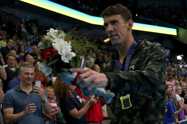 Michael Phelps Photos Photos - Michael Phelps of the United States looks on after participating in the medal ceremony for the Men's 100 Meter Butterfly during Day Seven of the 2016 U.S. Olympic Team Swimming Trials at CenturyLink Center on July 2, 2016 in Omaha, Nebraska. - 2016 U.S. Olympic Team Swimming Trials - Day 7
