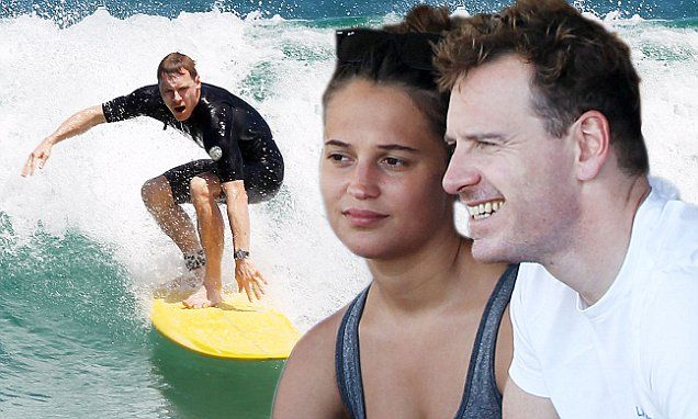 Michael and his co-star go surfing, and already, the reliable Daily Mail is going all Valentines over this sighting. :)