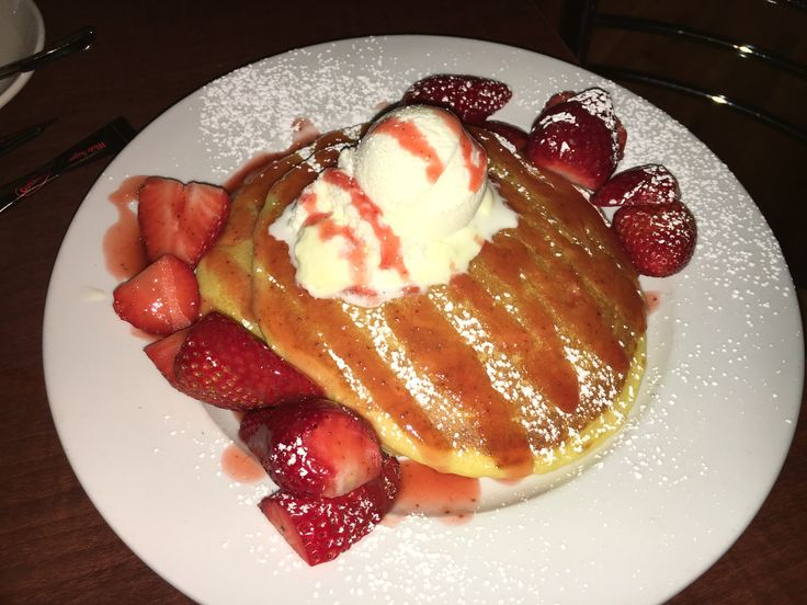 Strawberry Patch ( Buttermilk pancakes with fresh strawberries, cream, vanilla ice cream and strawberry coulis. )