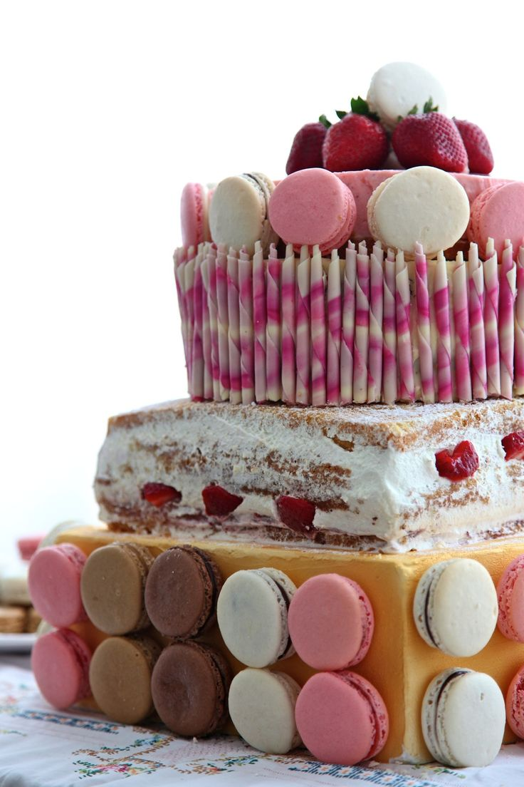 Three Tiered Pink Celebration Cake with Macarons