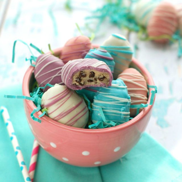 Pink, blue, purple, and white candy melts give these cookie dough truffles a colorful, Easter-themed update. Get the recipe at Lil' Luna.   - CountryLiving.com
