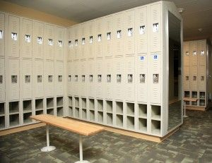 I love this idea for the locker room with shoe cubbies under the locker