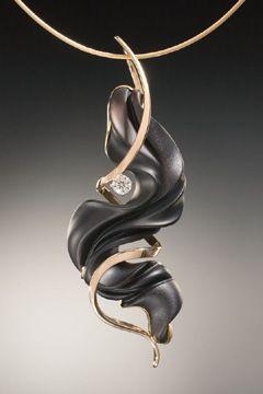 14K gold pendant, black onyx and .25 carat diamond. Sold.