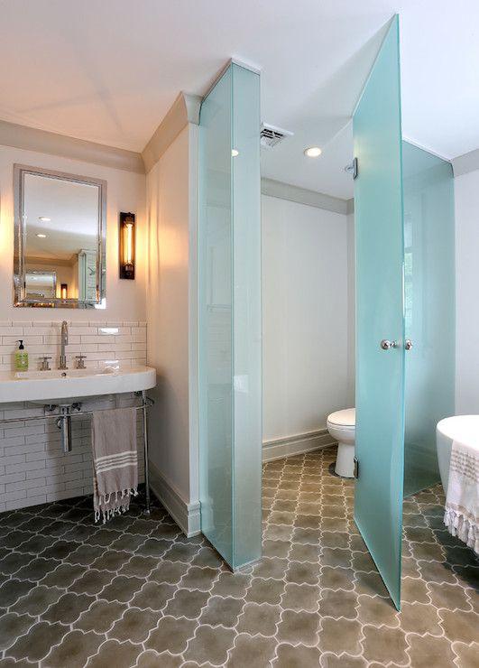 contemporary bathroom w/frosted glass doors & Moorish tile floor
