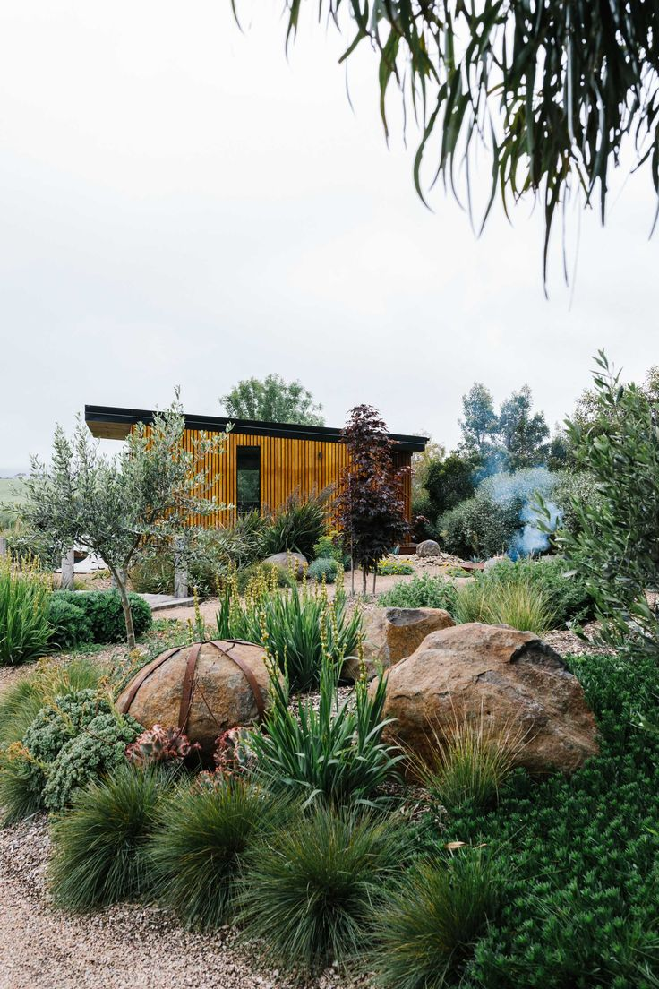 A garden which nestles into the surrounding landscape, mixing native and exotic plantings for foliage and textural interest. The use of locally sourced materials with drought hardy and frost tolerant plants. -Garden Landscaping Ideas-