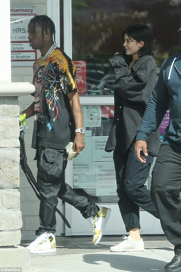 New couple: Earlier in the day, Kylie was pictured out on a date with her boyfriend Travis Scott, who was carrying a large wad of cash in his hand