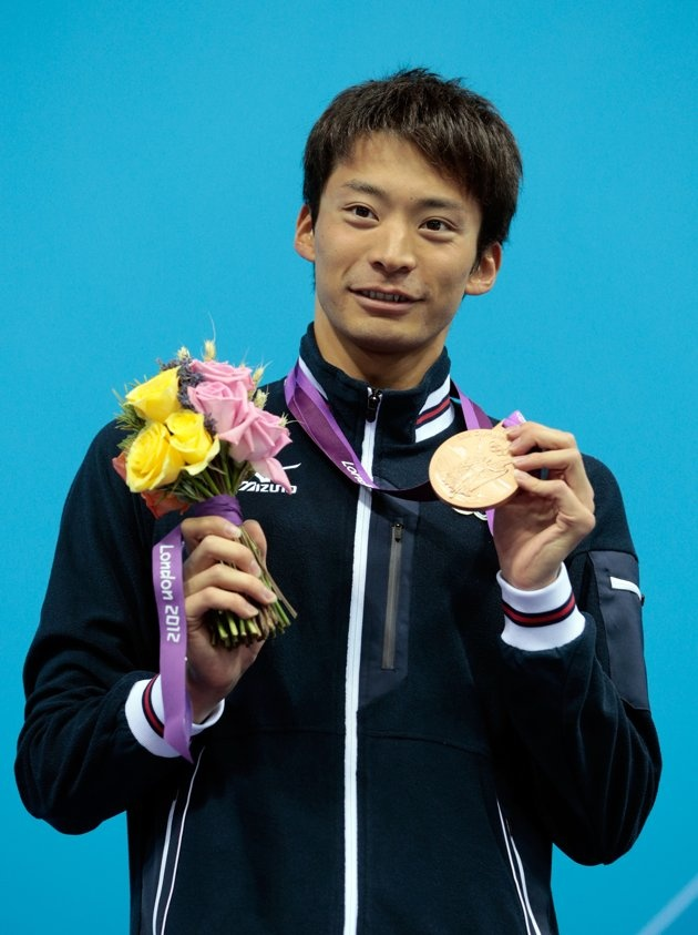 Day Three - JULY 30: Bronze medalist Ryosuke Irie of Japan celebrates with his medal during the medal ceremony for the Men's 100m Backstroke on Day 3 of the London 2012 Olympic Games at the Aquatics Centre on July 30, 2012 in London, England. (Photo by Adam Pretty/Getty Images)